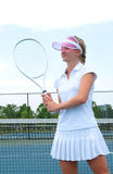 Young woman is playing tennis on the tennis court Royalty Free Stock Images