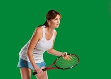 Young woman playing tennis Stock Photos