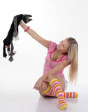 Young woman playing with toy cat Royalty Free Stock Photos