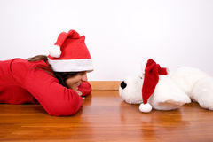 Young woman playing with toy dog in christmas Stock Photography