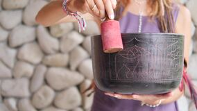 Woman With Tibetan Singing Bowl Stock Video - Video of