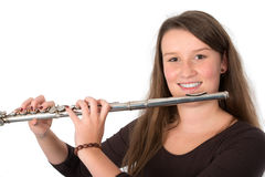Young woman is playing the transverse flute Royalty Free Stock Photo