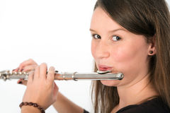 Young woman is playing the transverse flute Stock Photography