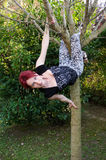 Young woman playing on tree Stock Image