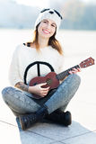 Young woman playing ukulele Stock Photos