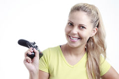 Young woman playing video game with joystick Stock Photo