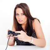 A young woman, playing video games Stock Photography
