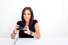 A young woman, playing video games Royalty Free Stock Image