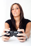 A young woman, playing video games. A young woman, playing a video game Stock Photo