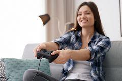 Young woman playing video games. At home Royalty Free Stock Photography
