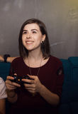 Young Woman Playing Video Games Stock Images