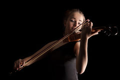 Young woman playing violin Stock Images