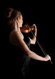 Young woman playing violin Stock Image