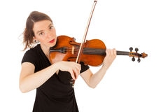 The young woman is playing the violin Stock Images