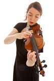 The young woman is playing the violin Royalty Free Stock Photography