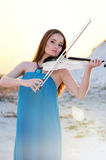 Young woman playing violin Stock Photography