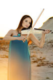 Young woman playing violin Royalty Free Stock Images