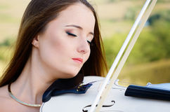 Young woman playing violin Stock Photo