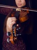 Young woman playing violin Stock Photos