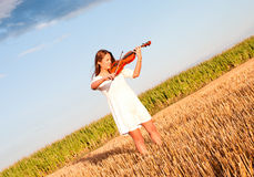 Young woman playing violin outdoors Stock Photography
