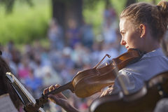 Young woman playing the violin at outdoors Stock Photos