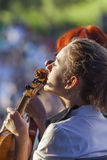 Young woman playing the violin at outdoors Royalty Free Stock Photos