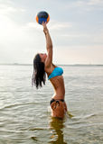 Young woman playing volleyball Stock Photo
