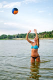 Young woman playing volleyball Royalty Free Stock Photography