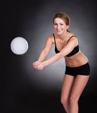 Young Woman Playing Volleyball Stock Photography