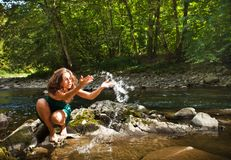 Young  woman playing with water Stock Images