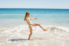 Young woman playing in water Royalty Free Stock Photos