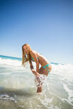 Young woman playing in water Royalty Free Stock Photo
