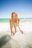 Young woman playing in water Stock Images