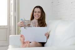 Free Young Woman Playing With Little Toy Shopping Trolley Running It On  Laptop Computer Smiling Happy Stock Photo - 72817640