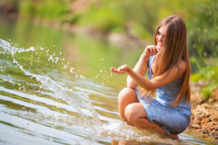 Young Woman Playing With Water Stock Photo