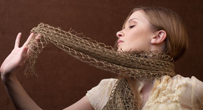 Young Woman Playing With Wrap Stock Image