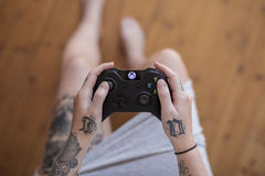 Young Woman Playing Xbox One Stock Photography