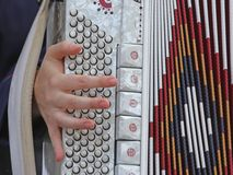 Young woman plays the ancient accordion keyboard Stock Image