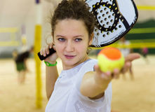 Young woman plays beach tennis on covered court Royalty Free Stock Image