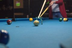 Young woman plays billiard. Sport concept Royalty Free Stock Images