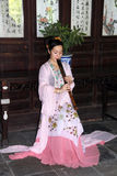 Young woman plays flute in Suzhou, China Stock Photo