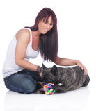 Young woman plays with french bulldog Stock Photos