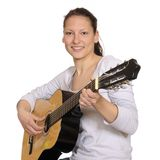 Young woman plays guitar Royalty Free Stock Images