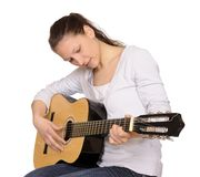 Young woman plays guitar Stock Image