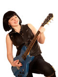 Young woman plays on a guitar. Young woman plays on a electric guitar Royalty Free Stock Photography