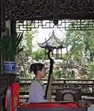 Young woman plays pipa at a free show for tourists in a garden in Suzhou Stock Photos