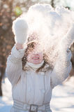 Young woman plays with a snow Stock Images