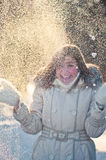 Young woman plays with a snow Stock Photography