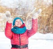 Young woman plays with snow Royalty Free Stock Photography