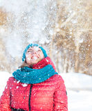 Young woman plays with snow Stock Photo